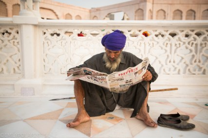 Indian man reading a newspaper at the Golden Temple, Amritsar.