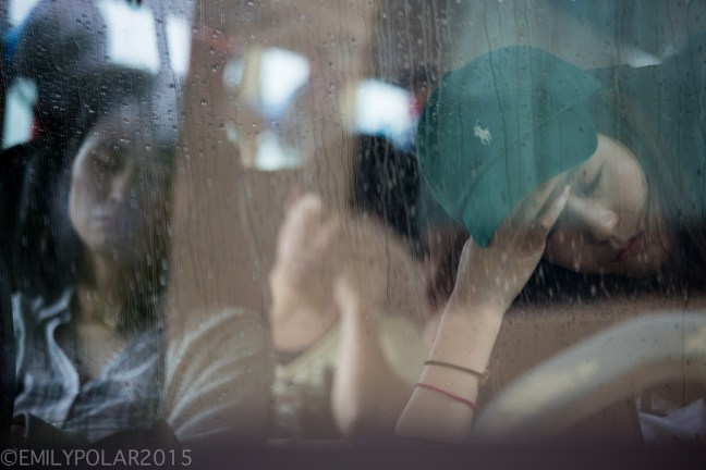Asian woman on a bus puts her hand on her forehead tired of waiting for the roads to clear.