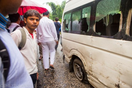Broken glass from the windows of a mini bus that crashed into another bus along the road to Pokhara, Nepal.