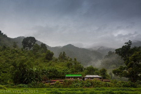 Homes in rural country side of Nepal in lush green hilly landscape.