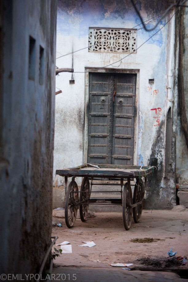 Wood street cart sitting in quiet streets of Pushkar down an alley.