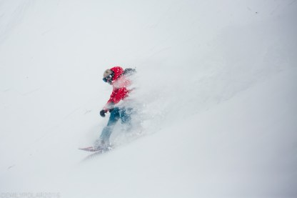 Snowboarders riding in deep powder in the backcountry of Nito in Niseko, Japan.