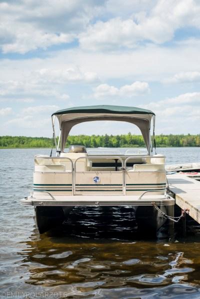 Pontoon Boat docked on Moshawquit Lake in Wisconsin.