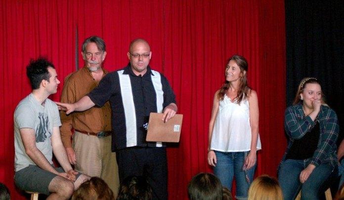 Decisions game, L-R: volunteer Paul, Jon, host Mike, Mara, volunteer Kaitlin