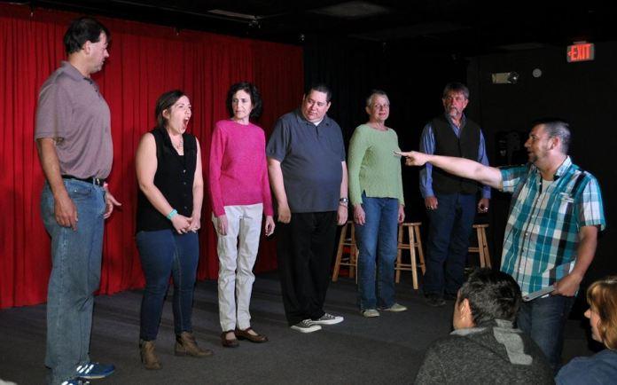 L - R: Robert, Whitney, Monica, Alan, Gail, Jon on tage, with host Cris pointing