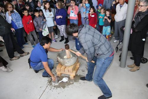 Mochi (rice) pounding in stone usu and wooden kine