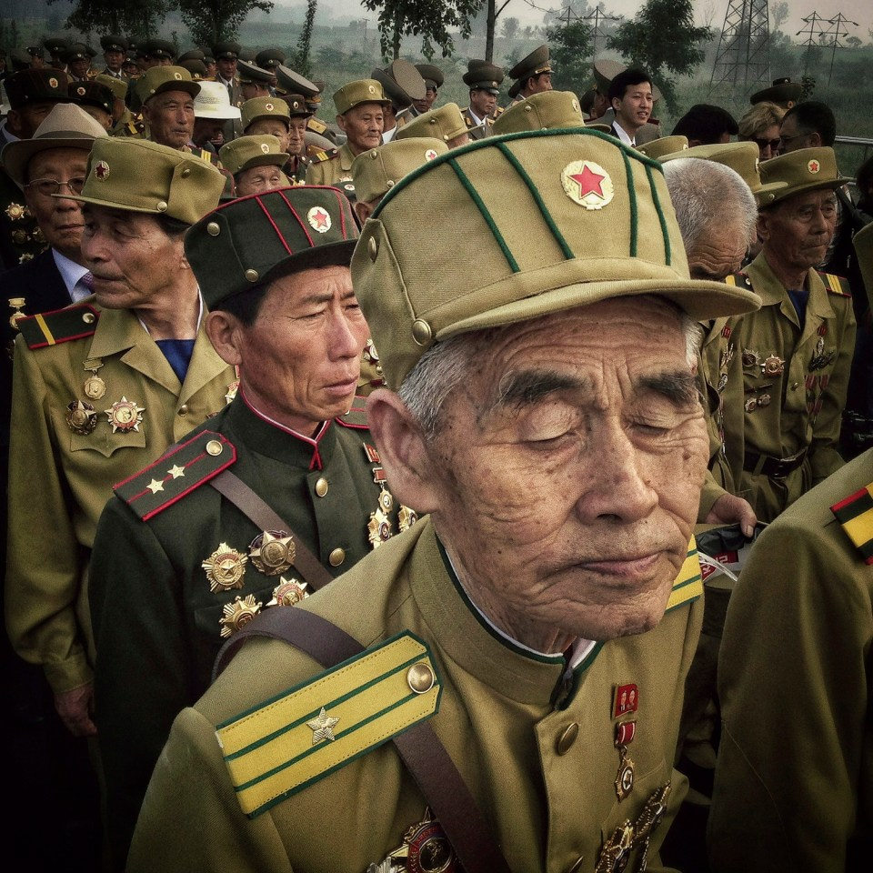 North Korean veterans of the Korean War enter a cemetery for fellow veterans in Pyongyang, North Korea during an opening ceremony marking the 60th anniversary of the signing of the armistice that ended hostilities on the Korean peninsula.
