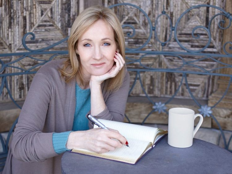 J.K. Rowling with a notebook and coffee