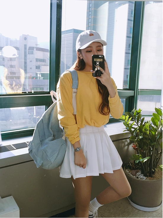 How Include A White Tennis Skirt in Your Next Outfit