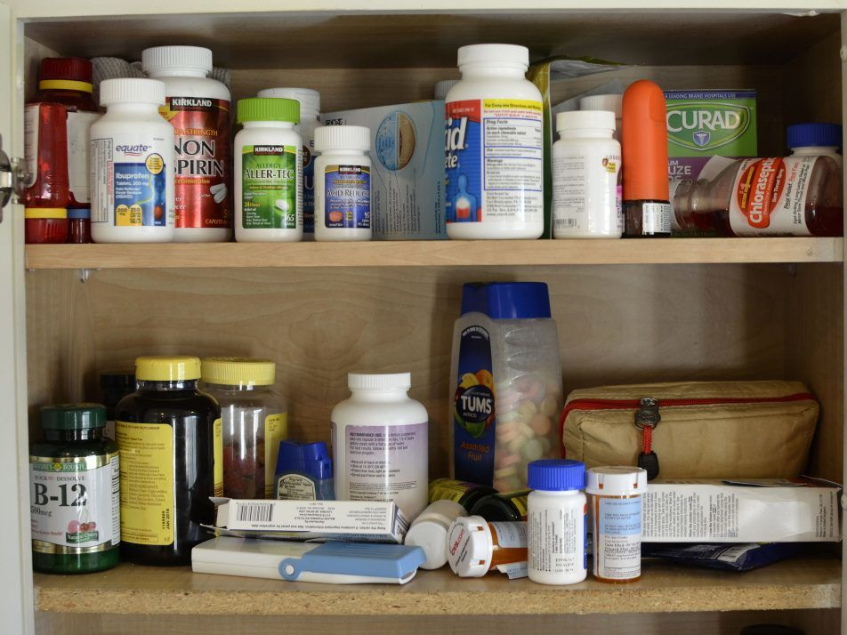 To show how a cluttered medicine cabinet in the kitchen is not necessary.