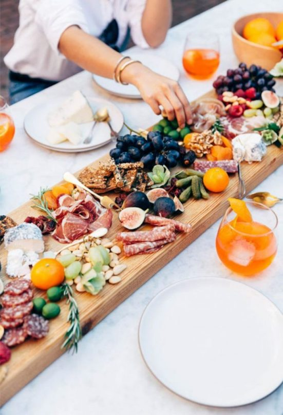 The charcuterie board has been all the rage for a few years now, and for good reason. They are the perfect solution for parties, as an easy appetizer, or even a snack dinner. I absolutely love creating a charcuterie board when I'm entertaining, because it has a little bit of everything and always varies with whatever I'm in the mood for! There are several elements that will make your charcuterie board the best possible, and a few things you might be forgetting to add. 1. Cheese Duh! This one is obvious, but I think the cheese drives everything else on the charcuterie board. It's one of the most important elements, because you will want to choose all the other items to compliment the cheese you pick out. I like to go with a variety of soft and hard cheese, including something spreadable like a Boursin. The easiest thing for your guests is to cut everything on the board, otherwise leave a small knife with the softer cheeses so guests can choose their own amount. If you have a specialty cheese shop near you, stop in and see what the cheese monger recommends! Choose the amount of cheese based on how many people will be indulging in your charcuterie board. 2. Meat The classic charcuterie board meats include salami and prosciutto. If you're vegetarian or your crowd is, don't feel like you have to include meat on your board! But if you do like the savory aspect of meat, go for a few different kinds of salami, folded in half for a nice presentation. For the prosciutto, I like to roll it so that each piece is easy to grab. You can stack them or place them in a roll this way. If it's available to you, try mortadella as well! 3. Nuts My best trick for displaying nuts on a charcuterie board, especially if you want it to look neater, is to place them in either small bowls or ramekins. If you don't have anything like that, then mini muffin liners work really well too! That way the nuts stay together and don't get hidden under the rest of the board. It's nice to create different l