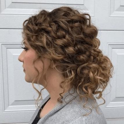 A braided bun on naturally curly hair