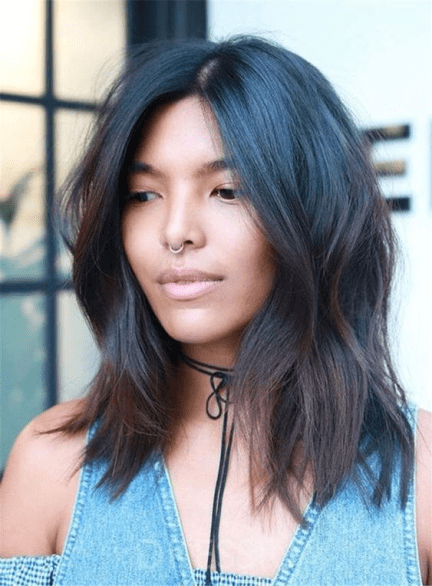 Center part on hair with a natural wave