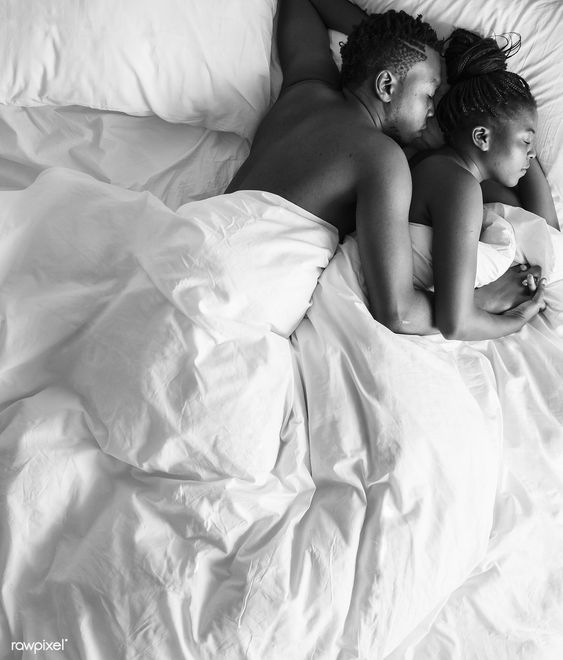 couple chilling in the bed together