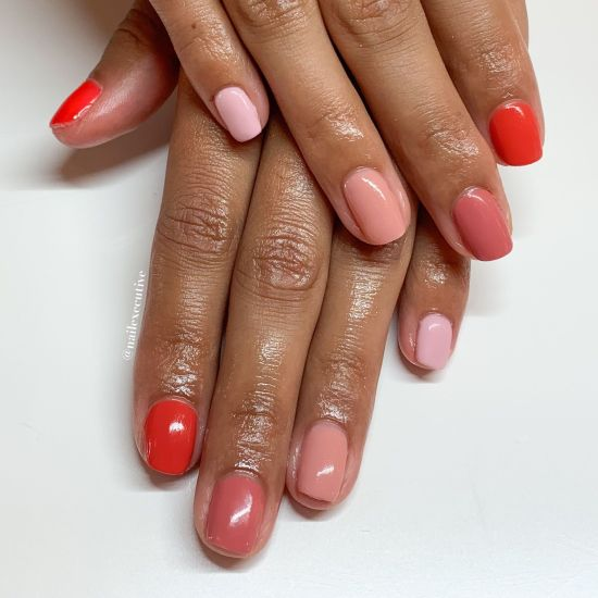 Pink and red nails for cancers.
