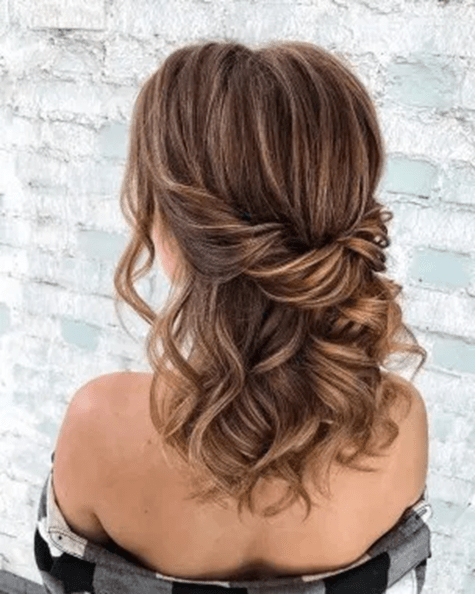 A simple half-up half- down on curled hair
