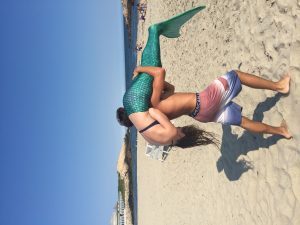 My twin giving me a lift into the ocean