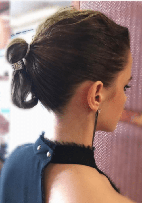 If you are looking to reinvent the classic ponytail, try this ponytail-bun hybrid that is complete with a futuristic silver or gold wrapping.