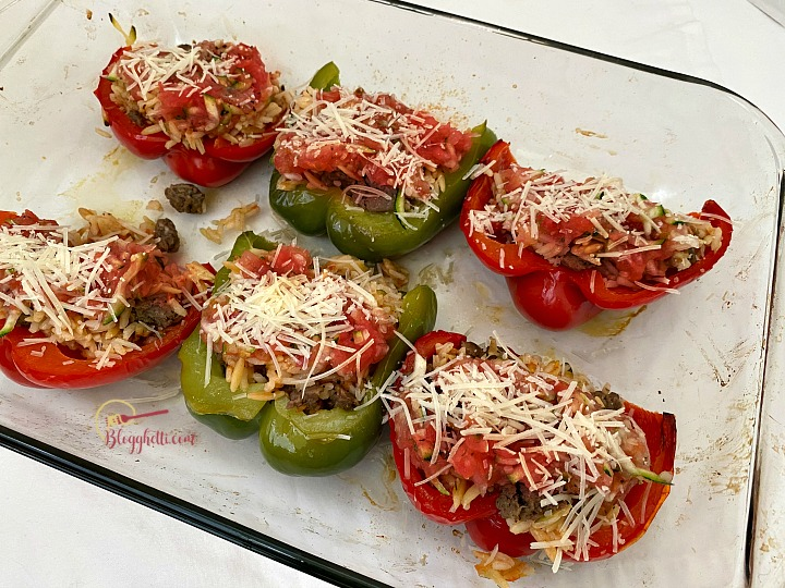 adding parmesan cheese to peppers
