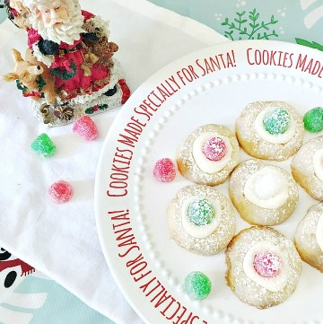 Sugar plum thumbprint cookies on Santa plate