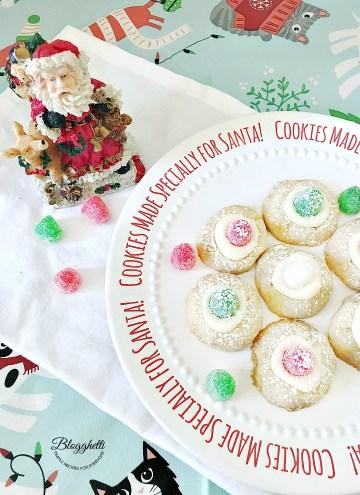 Sugar plum thumbprint cookies on Santa plate
