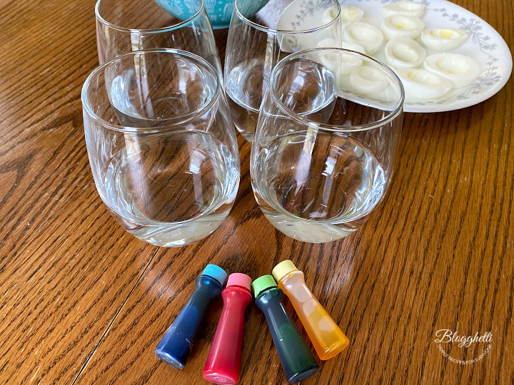 pastel food coloring and glasses for dying eggs