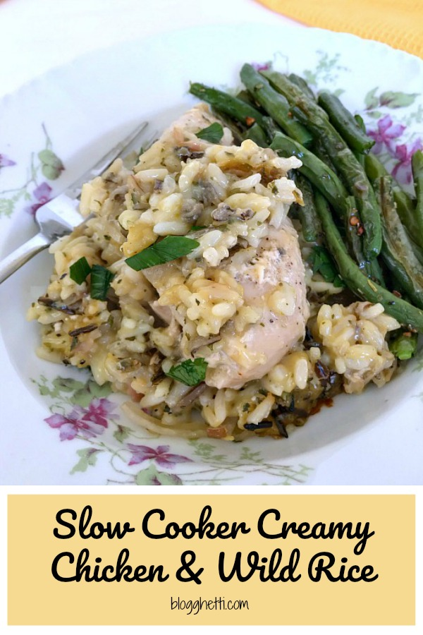 Creamy chicken and wild rice served with green beans on a plate