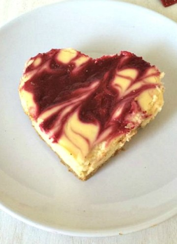 This easy White Chocolate Raspberry Cheesecake is perfect for the loves of your life! TThe white chocolate gives the cheesecake just a tad more richness, while the raspberry adds a bit of tart with sweet to the whole wonderful dessert. This is so easy that anyone can do it!