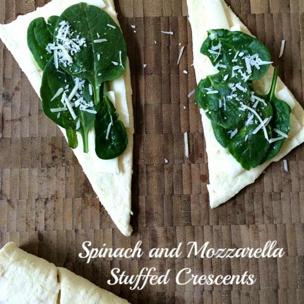 Light and fluffy crescents are loaded with cheese and spinach and make an easy appetizer or light lunch with a salad. #spinach #cheese #appetizer #crescents #meatlessmonday