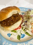 BBQ beef sandwich with coleslaw on blue plate