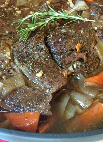 We call it melt in your mouth perfect oven pot roast for a reason. The meat is slow cooked in the oven with carrots and onions until the meat is fall-apart-tender and the carrots are tender crisp.