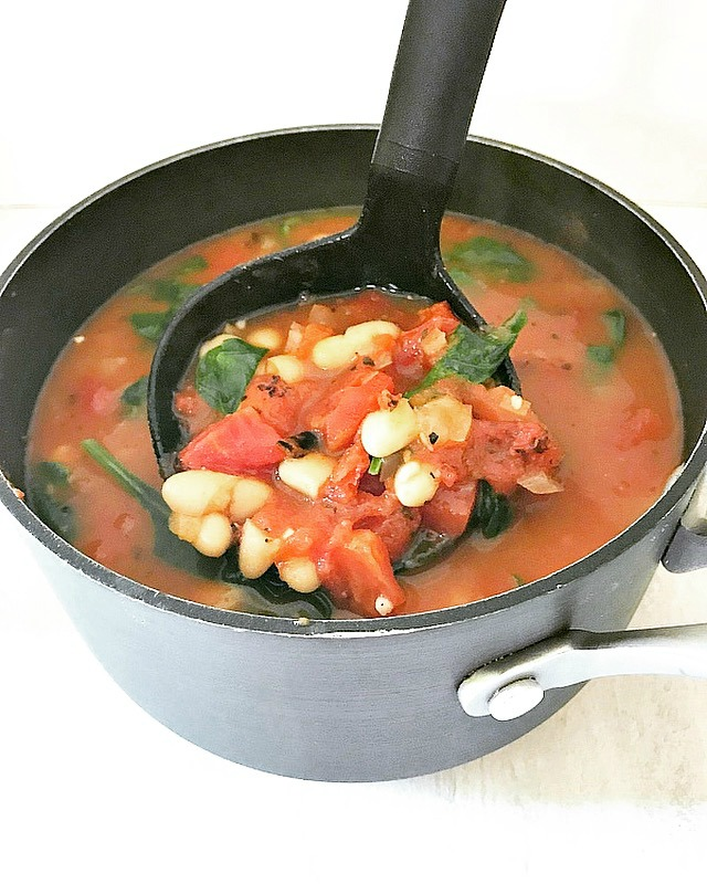 This vegan fire-roasted tomato and bean soup only takes 30 minutes to make, is full of flavor, and makes a great vegan weeknight meal.