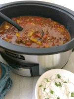 Slow Cooker Stuffed Pepper Soup is a hearty meal loaded with everything you love about a classic stuffed pepper - ground beef, rice and bell peppers, all in a tomato-based broth. #soup #stuffedpeppers #slowcooker #OurFamilyTable