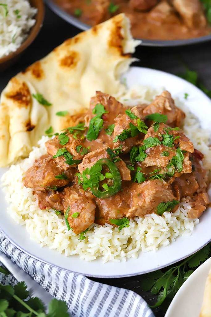 Easy-Chicken Tikka Masala served over rice on a white plate.