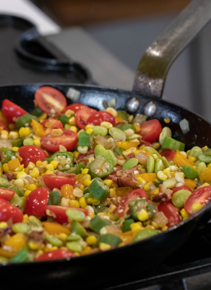 skillet with succotash, bacon, okra and tomatoes