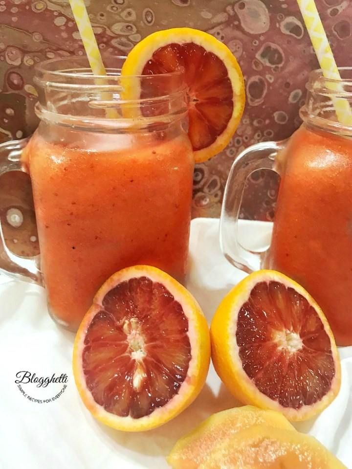 Blood Orange Strawberry Papaya Daiquiri with fruit in picture