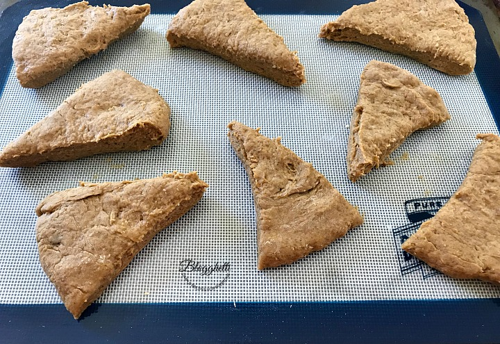 pumpkin spice scone dough cut into wedges ready to bake