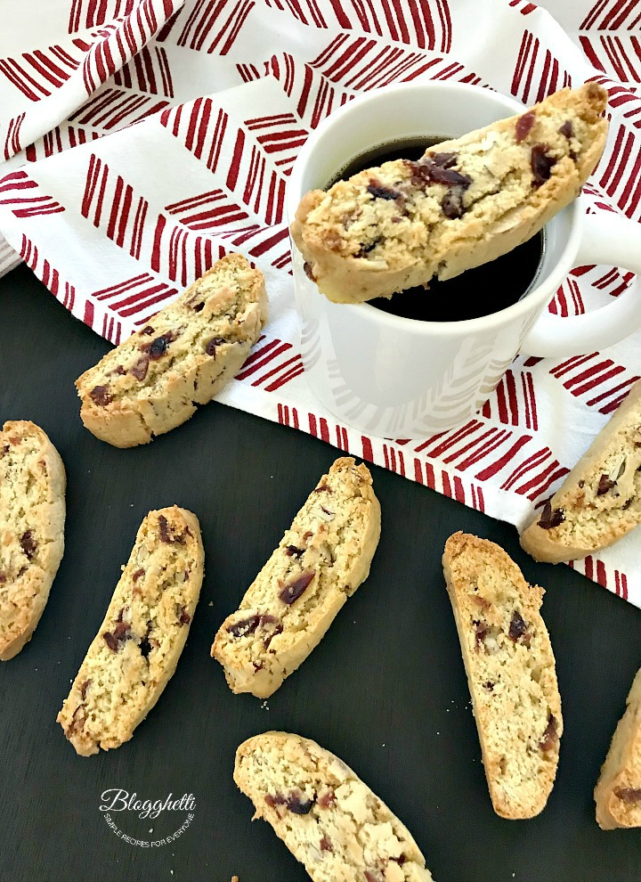 Cranberry Almond Biscotti and cup of coffee on a red-white towel