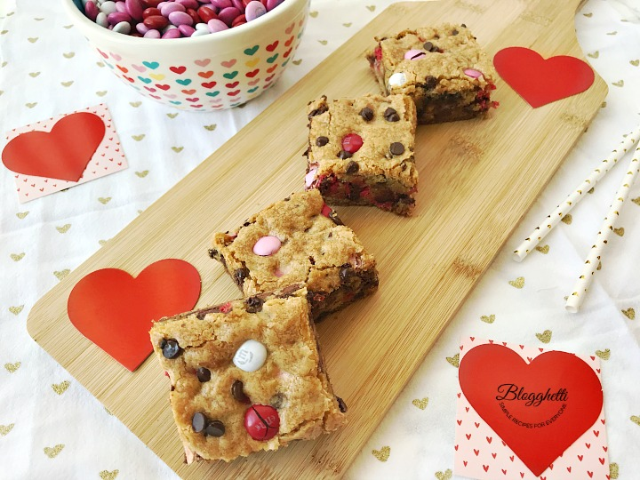 Valentine's M&M Cookie bar squares on wooden board
