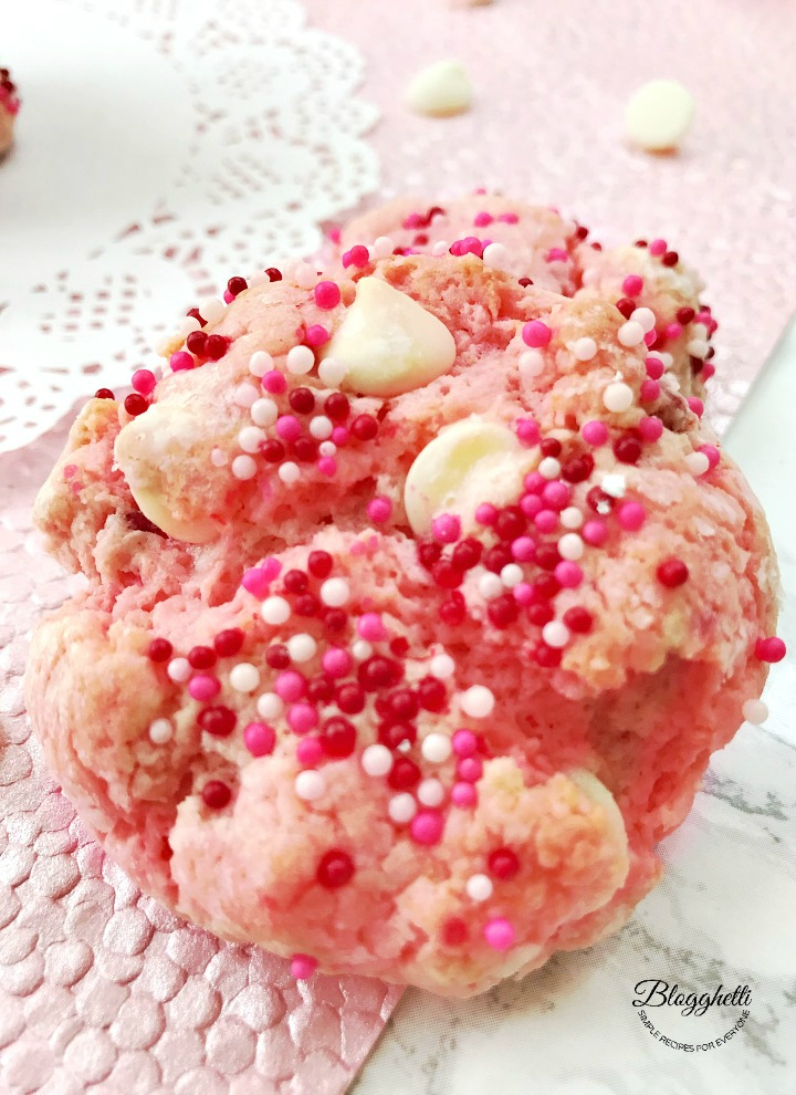 close up of strawberry cheesecake cookies with white chocolate