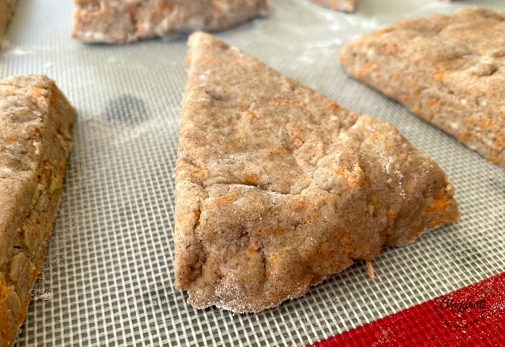 carrot cake scone dough cut into wedges