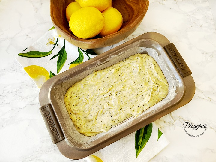 lemon poppy seed bread batter in an Anolon baking pan