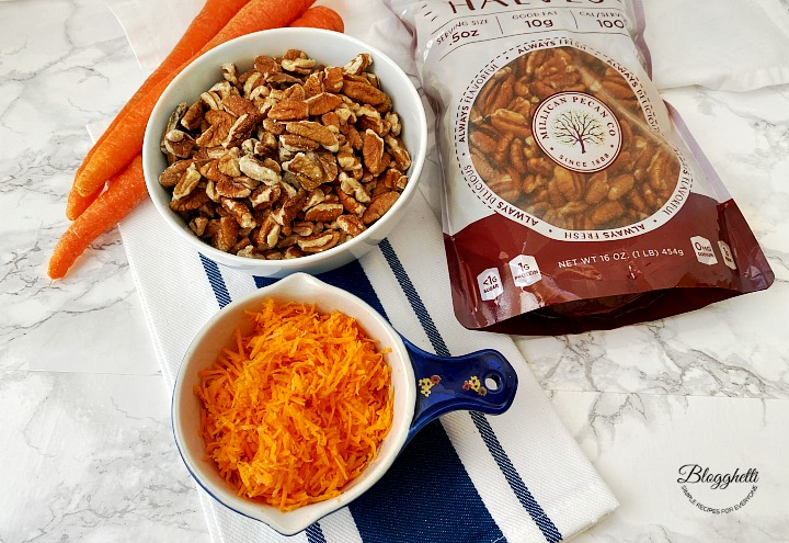 shredded carrots and chopped pecans in bowls