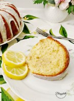 slice of lemon bundt cake with lemon glaze on white china plate