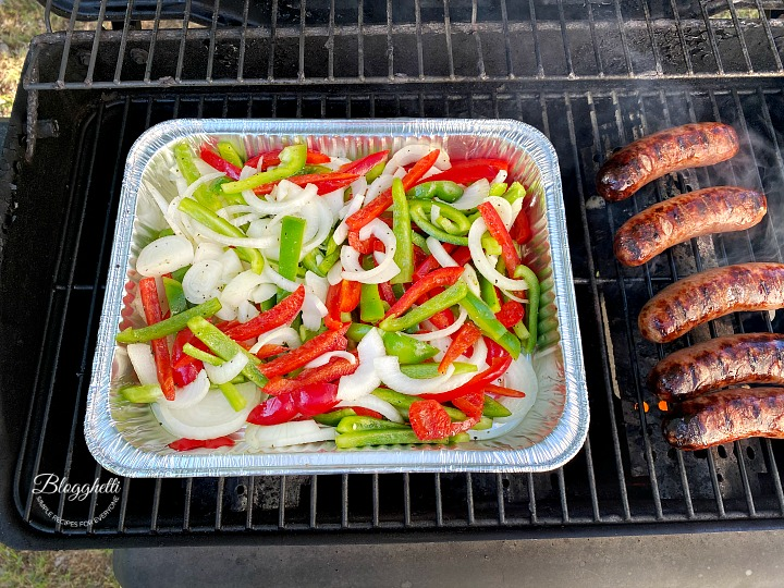 grilling the vegetables and sausages