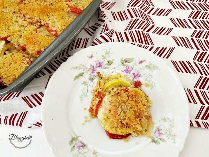 tomato and squash casserole on white plate