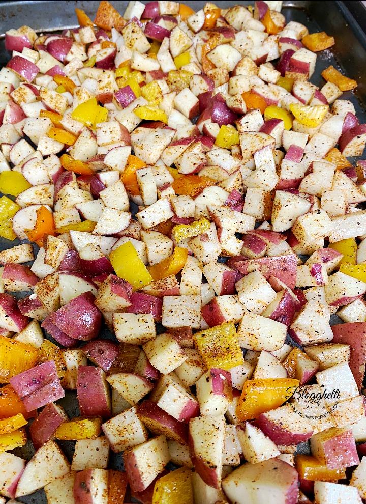 Old Bay seasoned breakfast potatoes ready to roast