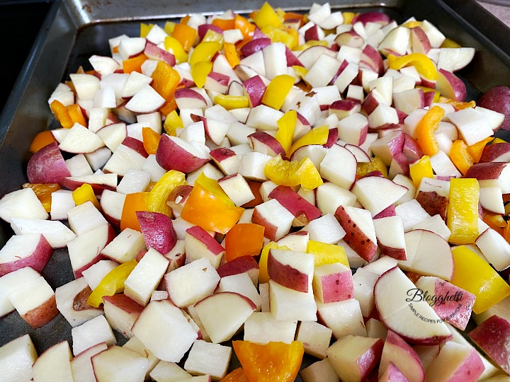 red potatoes and peppers ready to roast