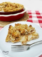 slice of Amish Pear Crumb Pie on white plate with fork