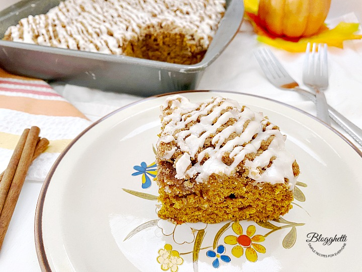 slice of pumpkin spice cake on beige plate